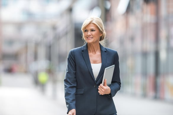 Smiling Business Woman holding a tablet